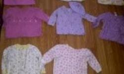$1 EACH or Whole Lot for $35   All 6-12 Months   8 Footed Onesies 8 Shirts 4 Onesies 3 Long Sleeve Onsies 2 Sweaters 3 Pants 4 Shorts 2 Outfits 2 Diaper Covers 10 Bibs(a few are brand new)   pls email call or text 403*7058