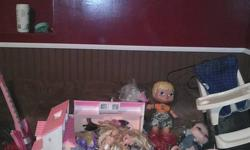 I hope your little girl can use these as much as mine did when she was younger Several barbies, older barbie house (needs cleaning) barbie guitar and assortment of things for the house There is strawberry shortcake figurines, my little pony and as seen