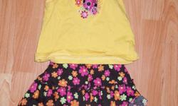"""""""George"""" (Wal-Mart brand) 100% cotton short-sleeved shirt & flowered skirt (with built-in bloomers) embroidered design on top yellow top was flowers and lady bug, pink has flowers and butterfly from smoke-free home   asking $3.00 per outfit or $5.00 for"""