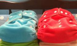 Four EUC Giggle Life Bamboo Cloth Diapers with two bamboo inserts. Retail value $19.99 each. Asking $10.00 each or $30.00 for the lot. The noodle and bright pink have staining inside; however it will come out with sunning. Diapers have only been washed