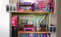 A large dollhouse for girls, and a Cory Teen Lounger, both in excellent condition (like new).