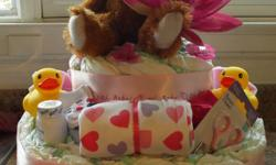 Looking for that special gift for a baby shower or welcome home baby??? Or maybe even a centre peice for the baby shower. This is super cute. I have a homemade diaper cake, which includes:  74 diapers, a teddy bear, 8 wash clothes, a blanket, 2 rubber