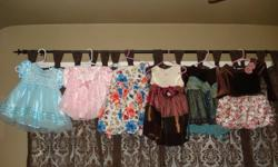 Set of six beautiful dresses like brand new each only worn once.Bought from sears,the bay.The all blue dress and all pink dress is 12-18 months and the rest are 18-24 months.