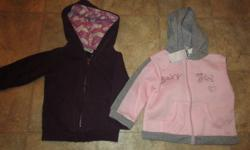"""Purple hoodie has a soft fuzzy material inside, and pink designs inside the hood. Pink """"baby girl"""" hoodie still has tags .. never been worn! Asking $5.00 for both. Both are in excellent condition. No rips or stains. Zippers work perfectly. Will not be"""