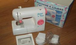 girls sewing machine never used bought at sears a few years ago makes a great christmas present great for those little prjects. $25.00