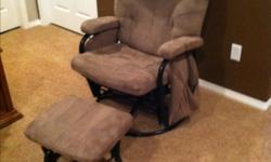 Brown glider chair and matching ottoman. In good shape, has pockets on side for keeping books or magazines handy. Great chair for breast feeding. This ad was posted with the Kijiji Classifieds app.