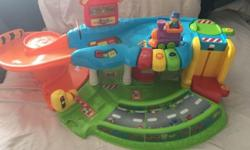 Go! Go! Smart Wheels Tow & Teach Garage in a good condition. Interactive garage combines pretend-play fun and learning elements.Features learning mode and music mode. Teaches pretend play, colors, vehicles and weather. Pet smoke free home. Plz contact if