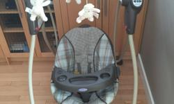 Graco Baby Swing For Sale, excellent condition. Only used at grandma and grandpa's house!