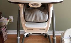 High chair and booster seat in excellent used and clean condition. 15 months old from a smoke free home. Retails for $260. This is a very sturdy, well built chair system. Below is the online product description: High chair and infant feeding booster,