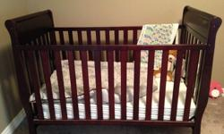 Brown, used for two kids, ages 3 months- age 2.