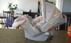 Beautiful Gray and Pink Graco Infant Carseat for sale. In excellent condition.