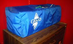 Graco Playpen is in excellent condition with no rips in the mattress or mesh siding   Comes with 2 home made fitted sheets   Color is Blue with Primary colors in the mattress and does not have the crinkle/noicey material like on some playpens. A must see