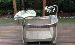 Selling a Graco Play pen with change table and mobile.