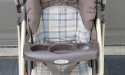Graco Quattro Tour Travel System features: Includes stroller, carseat, base, and weather shield Stroller reclines completely flat (great for naps) One-hand gravity fold on stroller Lockable front wheels (for rough surfaces) Drink holders and small storage