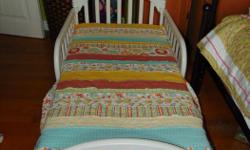 White Graco toddler bed ,has two side rails. Great condition-(it fits any crib mattress)