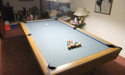 4x8 slate pool table, cues, 2 sets of balls, scoreboard, brush, cover,pool games & fixture over the table
