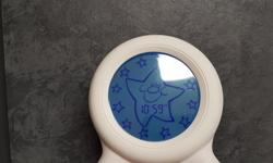 Used Gro Clock. This clock displays a countdown (using a ring of stars) to help your child know when it is time to wake up in the morning or from a nap. We used this from about 2-6 with our daughter. It works great. We don't have the box or manual but