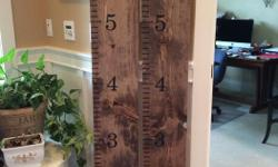 """These growth charts are stained and measure 9""""x6'. They are priced at $40 each. One has an embellishment that reads """"All things grow with love""""."""