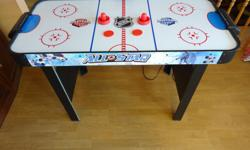 "Halex NHL All Star Air Hockey Table. Compact size: 48"" L X 23"" W. Electronic and manual scoring. Includes table, two paddles and 2 pucks."
