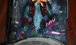 This collectible toy was created by Joyride Studios for Halo: Combat Evolved, the first game in the Halo franchise. It is still in the original packaging; it was never opened. This is Series 4: Red Covenant Elite. This one is 1174SS, which means it was
