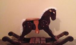 """Solid wood, handcrafted rocking horse. 27"""" high X 44"""" long. Excellent condition. $135"""