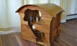 """Up for sale is a beautifully hand crafted waldorf style wooden play house / doll house. It is finished with non-toxic oils and has been in a non-smoking environment. The base measures 22"""" x 24"""" and stands 25"""" tall. Everything inside the playhouse is not"""