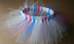 Handmade Doll Tutus. Perfect little stocking stuffer for your daughters dolls and stuffed animals. Tutu has a 9 inch waist band. buddingbabyboutique.weebly.com