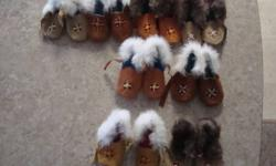 Beaded Handmade Slippers High Quality Sizes 0,1,2,3,4,5 (all have leather ties) Girls & Boys available Sizes: 0-2 = $25.00/pair Sizes: 3-5 = $35.00/pair Made with, moose skin, beaver skin, rabbit fur. Custom orders available in children's and adult sizes.
