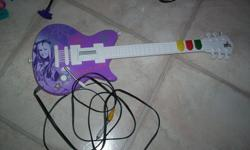 Very similar to Guitar Hero. You have to push the colours at the same time the music notes play music of Hannah Montana songs. In excellent working condition.