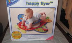 Tummy time infant flyer. Only used once. Still in the box. Comes from a smoke free home.