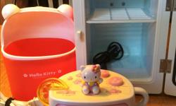 Included in this Hello Kitty lot is a red excellent briefly used condition mini fridge that works great! You will also receive a new desktop waste basket and excellent used condition working alarm clock. All items are just adorable, but we are selling as