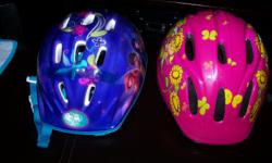 Two bike helmet for girls, exellent condition for ages 4-6 yrs old... or trade for stroller umberalla