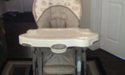 Evenflo high chair excellent condition two detachable tables can attach toys adjustable foot rest top of the line paid 300 brand new if interested call Keith 204-804-9973