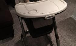 Graco high chair for sale. It can adjust up and down and recline, has one small and one large tray, can convert into two different types of booster seats. Great condition, just has a little wear on the seat.