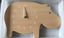 Suitable for nurseries and other home decor projects, this minimalist clock consists of an easy to read face painted on a solid wood cut-out design. Requires single AA battery. 7.5 inches x 11.3 inches.