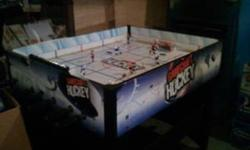 GameCraft hockey table in good condition, not used much. One goalie fell off but can be easily glued, one extra player included.