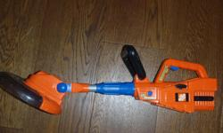 Home Depot Battery Powered Childs Weedeater,works great,sound of motor,wheel spins and lights up at bottom,extendable shaft,great shape