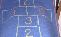 Hop Scotch Rug in excellent condition. 36 inches wide by 78 inches long, 100% nylon.