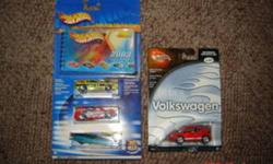 This is an assortment of  15 unopened Hot Wheels, Johnny Lightning and assorted diecast vehicles, , and a box of 15 matchbox or 15 hot wheels