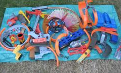 A whole bunch of once costly Hot Wheels stuff accumulated over time by the boys . Loops and tons of track and all things in between for the young enthusiast . ~ $ 60.00 for the lot