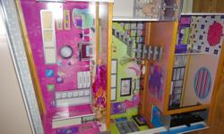 The biggest barbie house ever. It has an elevator and comes with some Barbie dolls. $60.00 only First come first serve