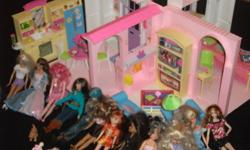 Everything in photo is included.  Barbie house, furniture, accessories, clothing and all barbies.  Sadly, we have outgrown barbies!  Everything very well taken care of!!!
