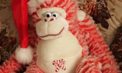 Christmas candy cane monkey, long arms, cuddly, ready for Christmas, picture shows how large the monkey is as my son is sitting beside it and he is 2. Check out my other adds.