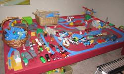 HUGE Thomas Table and LOTS of trains.  Solid wood, beautifully constructed wooden table for hours of Thomas fun.  Please note, table is 5 feet by 8 feet -perfect space for huge track set-up.