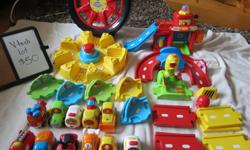 Big lot of EUC Vtech Go Go Smart Wheels cars, track and fire station. Includes 11 vehicles, lots of track pieces, fire station with ramp, traffic light, bridge, tire-shaped car carrier and car launcher. All cars in great working order, with sounds, lights