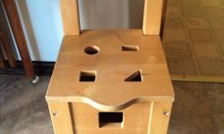 This chair is great for little ones shoes & has 4 blocks that go through the top