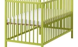Green Ikea Somnet crib with mattress. All is in very good condition, our child has now moved into a bed. The mattress has no tears or stains and is actually better than the one in the picture. The crib is straightforward, but served our daughter perfectly