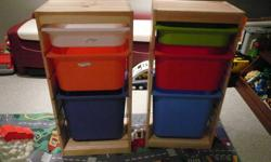 Ikea trofast Storage Bins/Pine frame. Bins in excellent condition. Bins in one are blue, orange and white, Other one blue, red, green. One frame has a crack but face it to the back and you don't see it. You can also fix it with wood glue, I just didn't