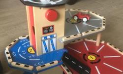 Imaginarium vroom vroom garage. Sturdy wooden construction. 3 levels. Comes with car & helicopter. Excellent condition.
