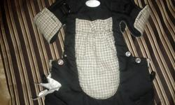 Black and beige snugli. Brand name Infantino. It can be used 6 different ways. Instructions written on strap. Barely used as my baby didn't really like it. From clean smoke free home.